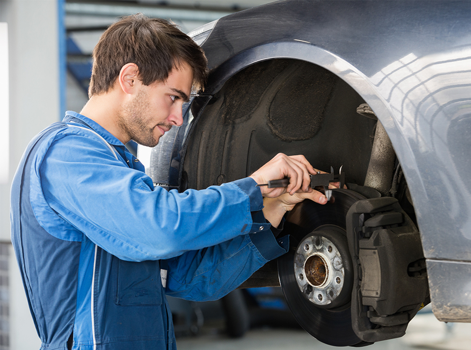 Mechanic repairing a vehicles brakes - Brakes Long Eaton